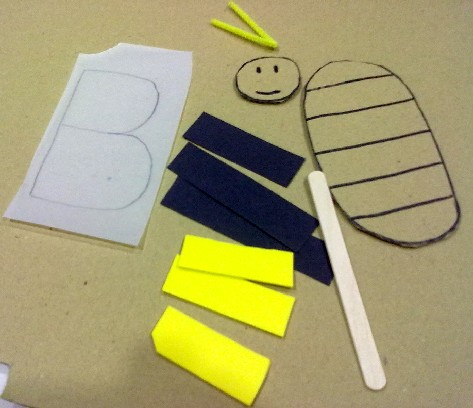 now youre ready to make your bee 5 have your child colour the letter b on the sheet of tracing paper